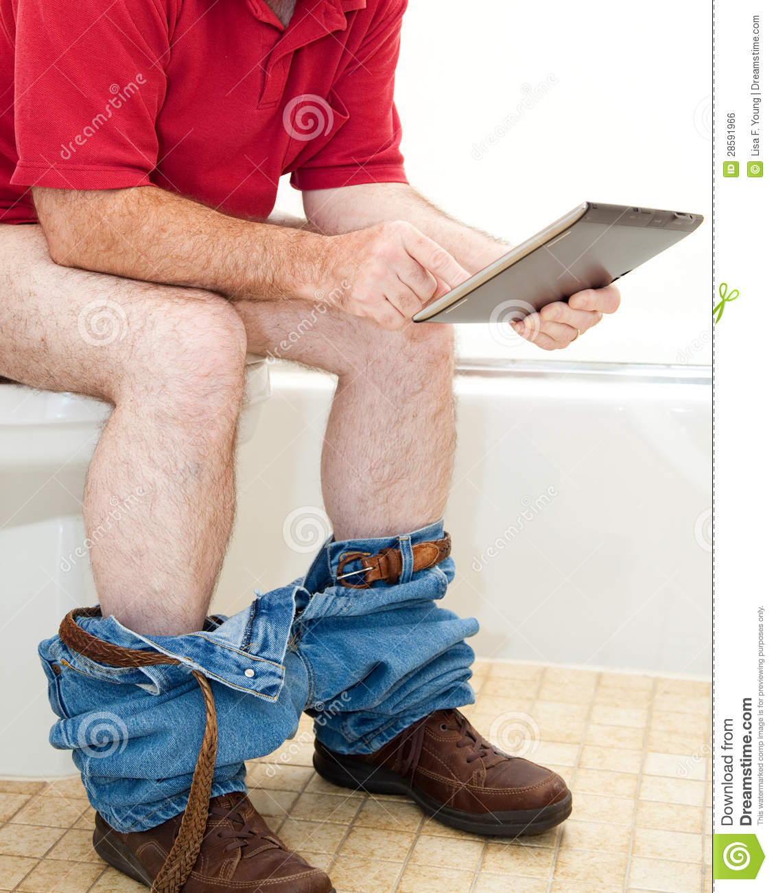 Man On Toilet With Tablet Pc Royalty Free Stock Image