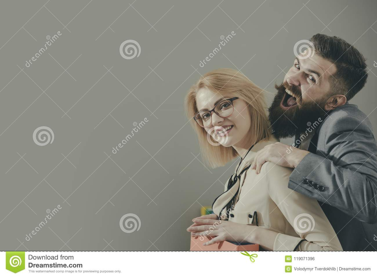 Man touching female coworker on shoulder in inappropriate way in office, copy space