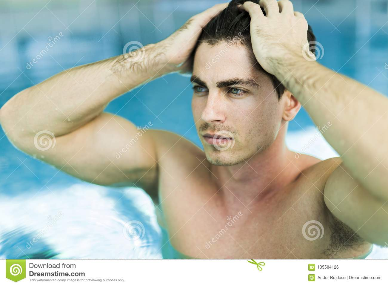 Man touching his hair in the swimming pool