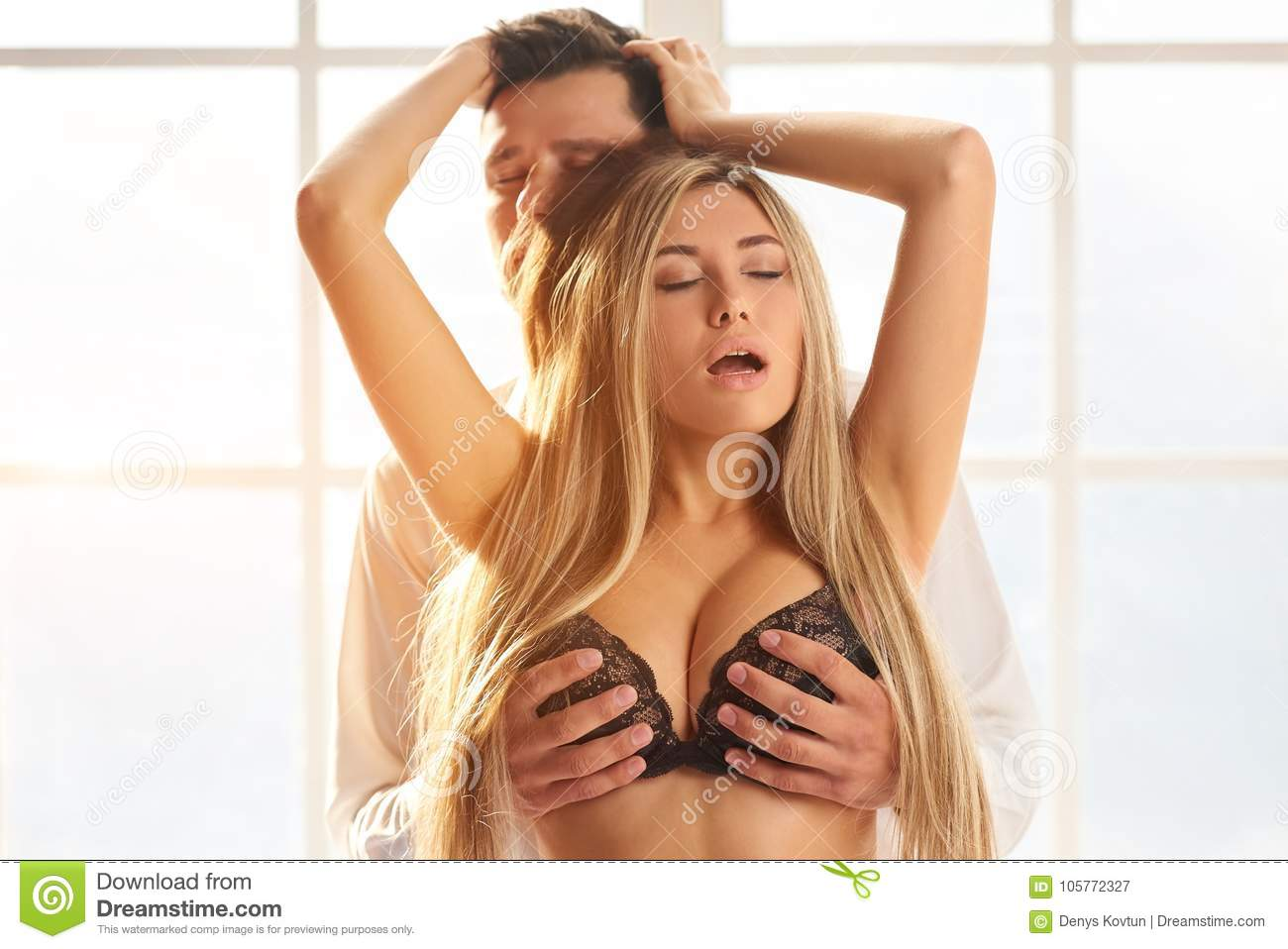 Man touching woman`s breast.