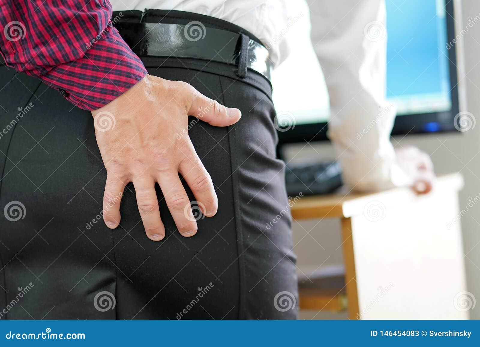 Ass Grope man touching woman`s stock image. image of employed - 146454083