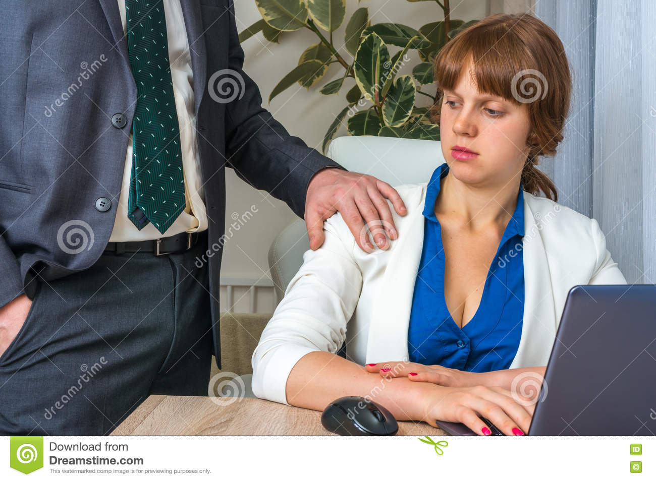 Man touching woman`s shoulder - sexual harassment in office