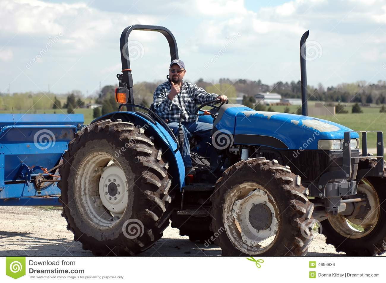 Guy On Tractor : Man on tractor stock photo image of blue driving farmer