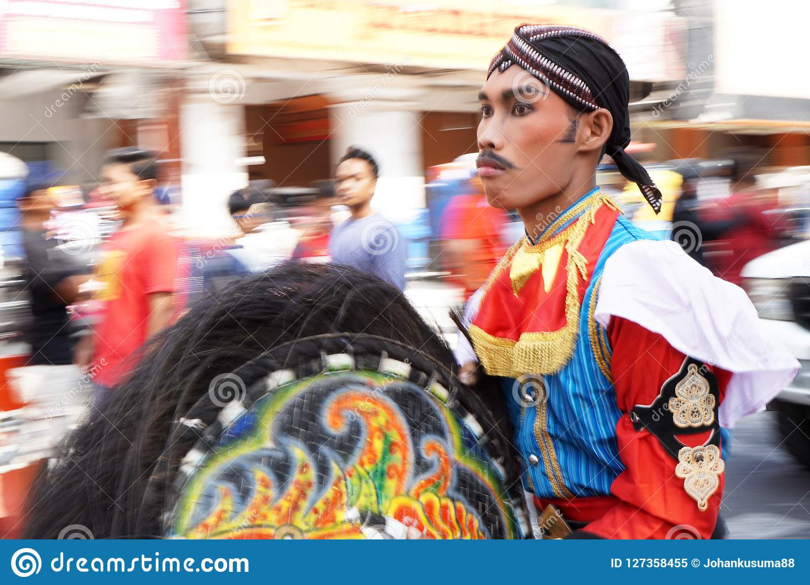 Man in traditional costumes are parading on Malioboro street, Yogyakarta. Photos taken with panning techniques