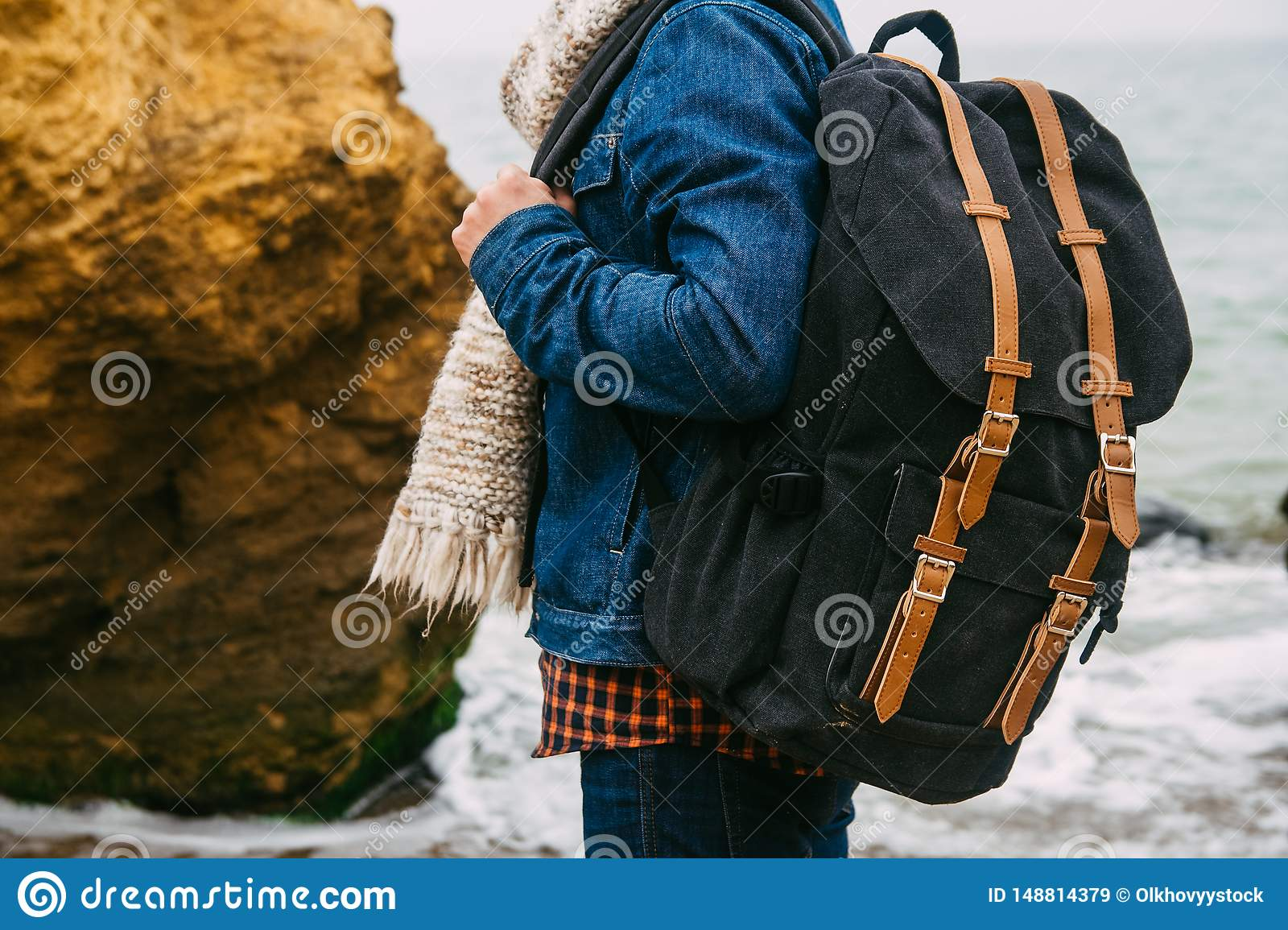 Man traveler with backpack. The concept of travel is discovering new places