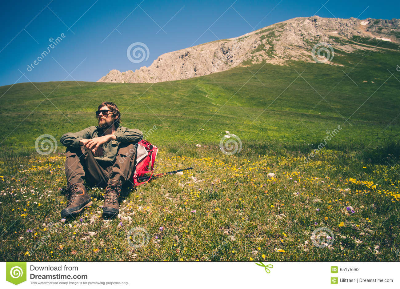 Man Traveler with backpack relaxing outdoor Travel Lifestyle concept