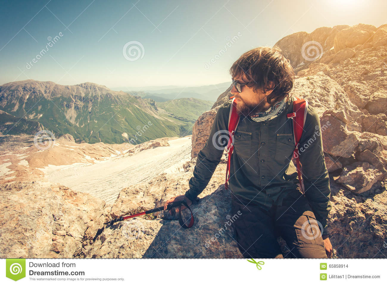 1cc9439d7473 Man Traveler bearded with backpack relaxing Travel Lifestyle concept  mountains on background Summer vacations activity outdoor