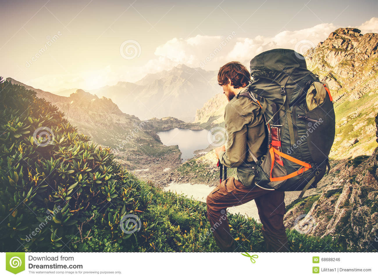 6d66b9fc8ffa Man Traveler with big backpack mountaineering Travel Lifestyle concept lake  and mountains on background Summer adventure vacations outdoor