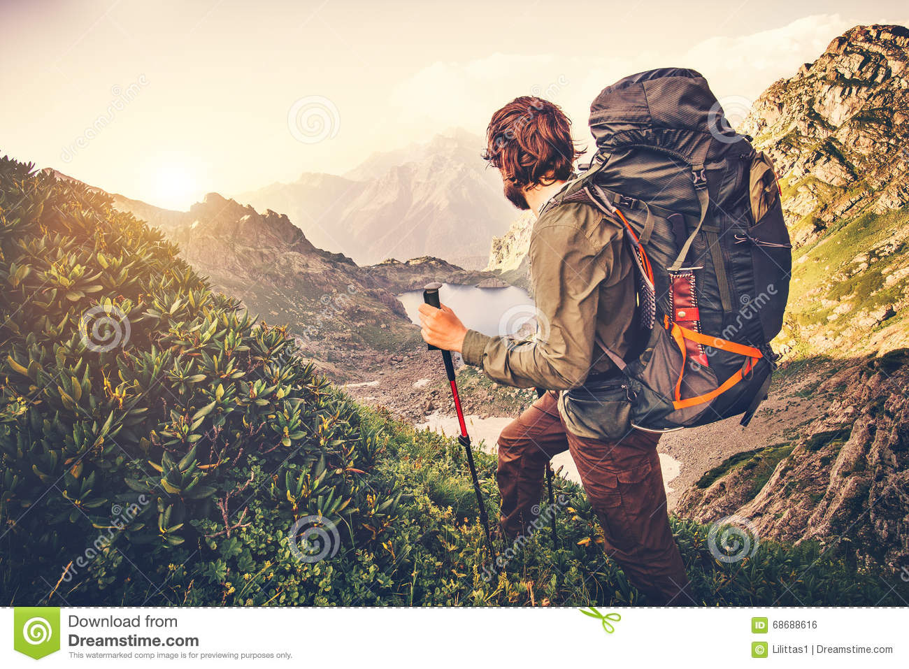 Man Traveler with big backpack mountaineering Travel Lifestyle concept