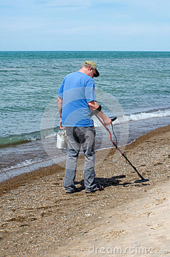 Jew Detector: Man Treasure Hunting On The Beach Stock Image