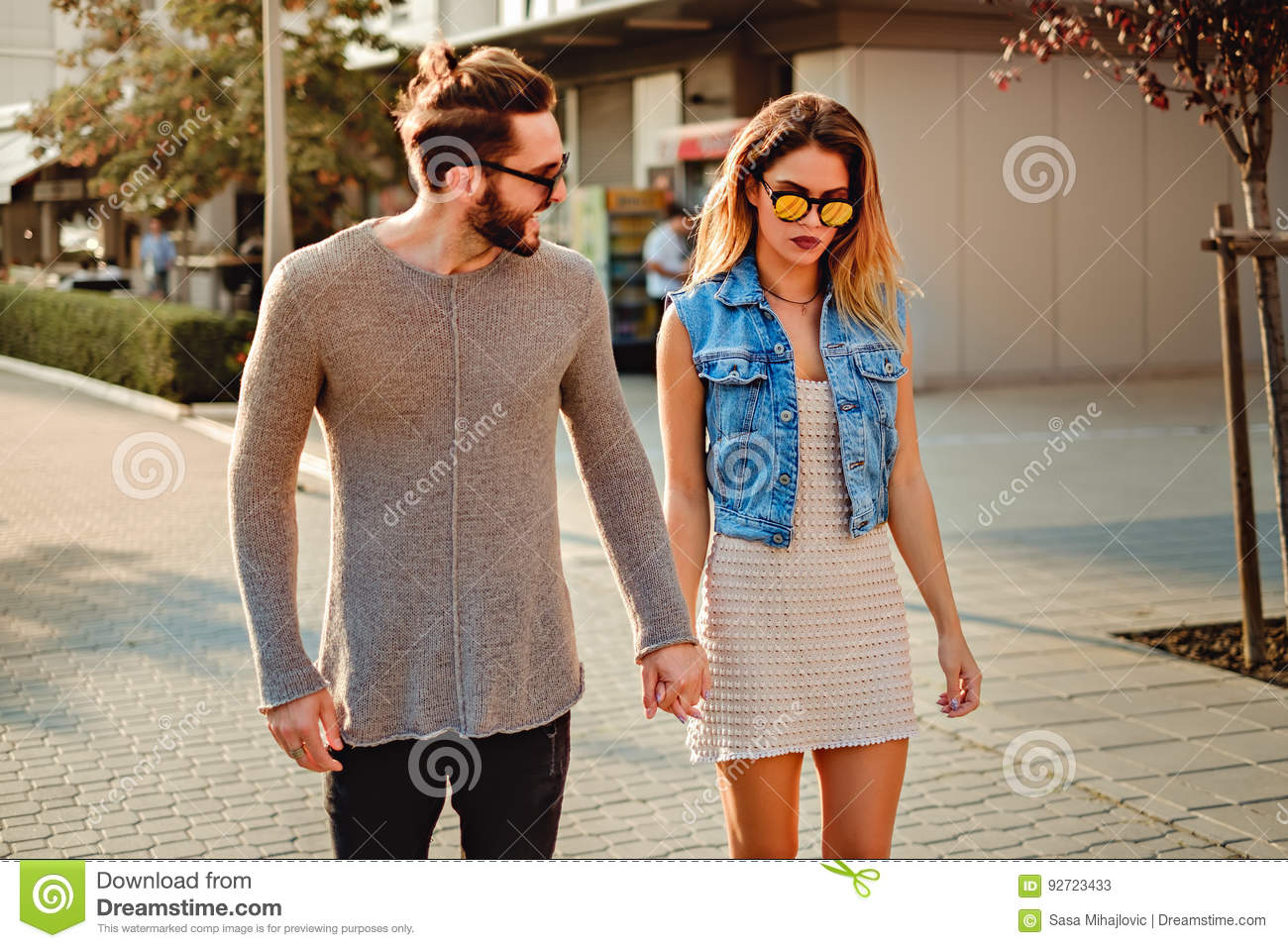 Man Trying To Cheer Up Girlfriend While They Walking Stock Image