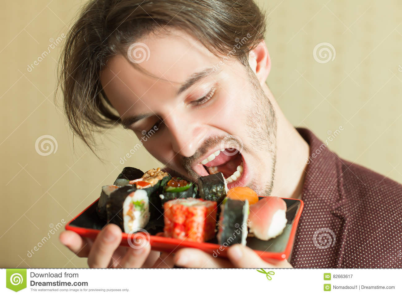 man trying to eat sushi set without hands stock image. Black Bedroom Furniture Sets. Home Design Ideas