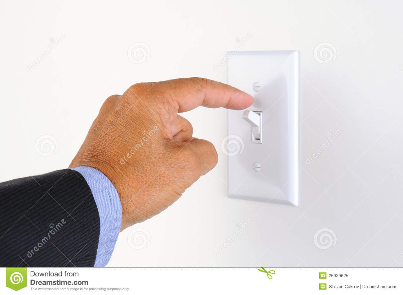 Man's hand with finger on light switch, about to turn off the lights ...