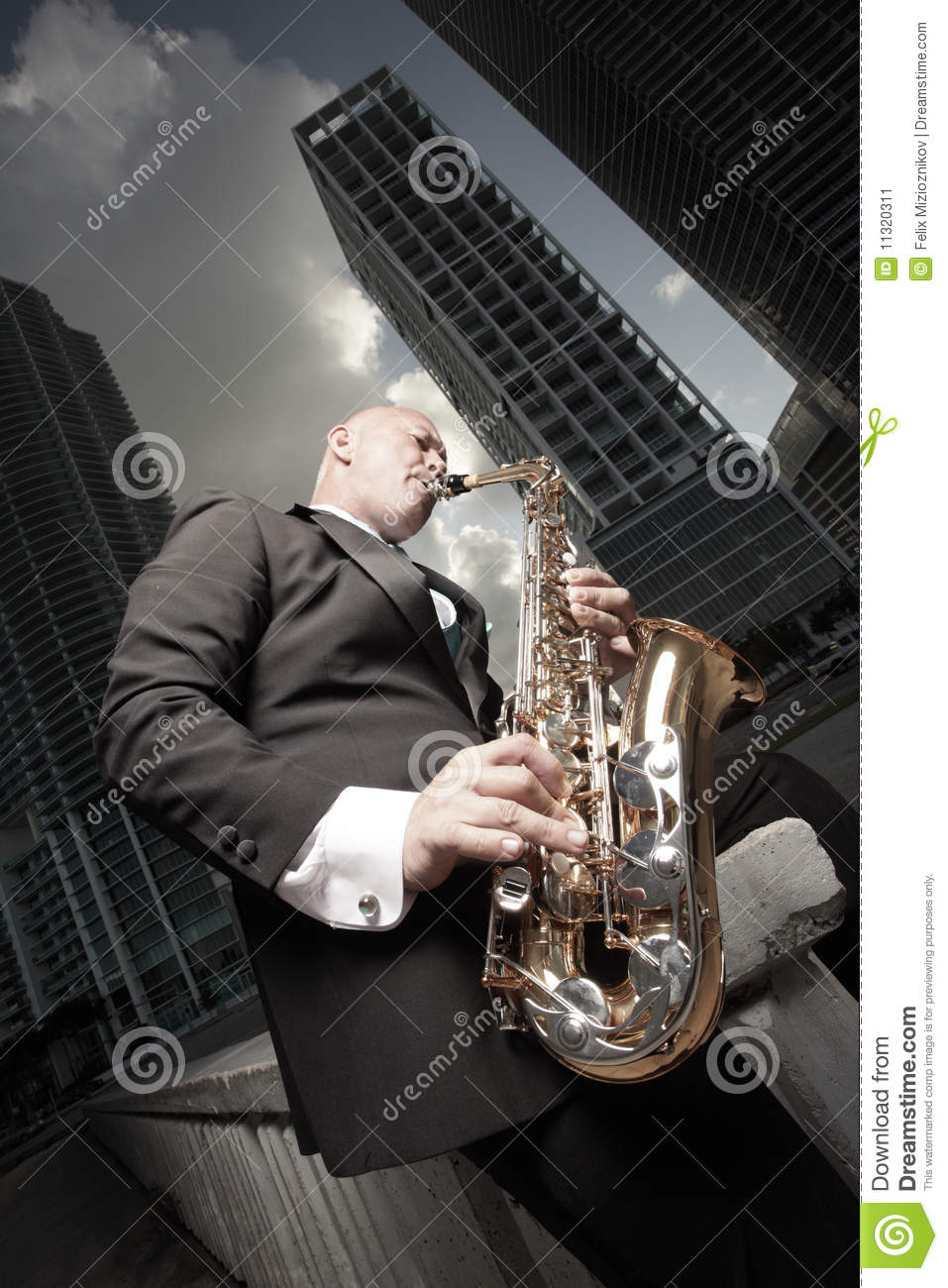 Handsome man outside in a tuxedo playing a saxophone Handsome Man In Tux