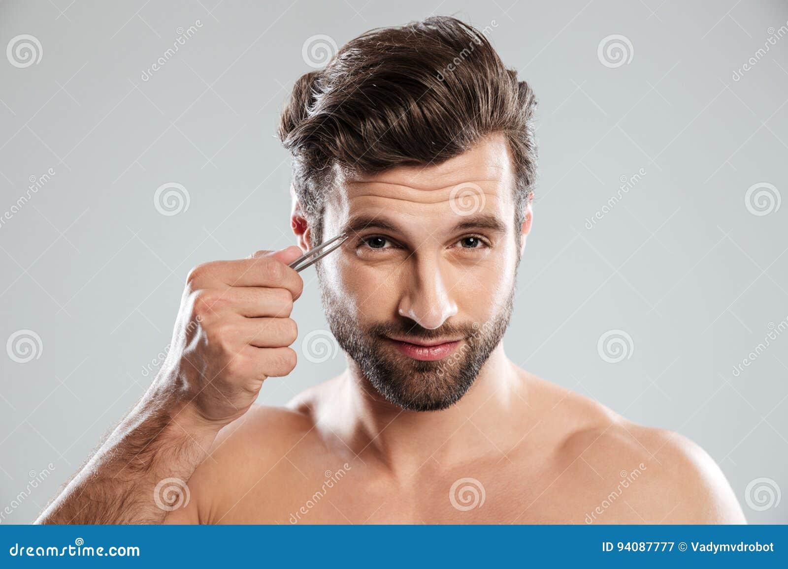 Man Tweezing His Eyebrows Isolated Stock Image Image Of Picking