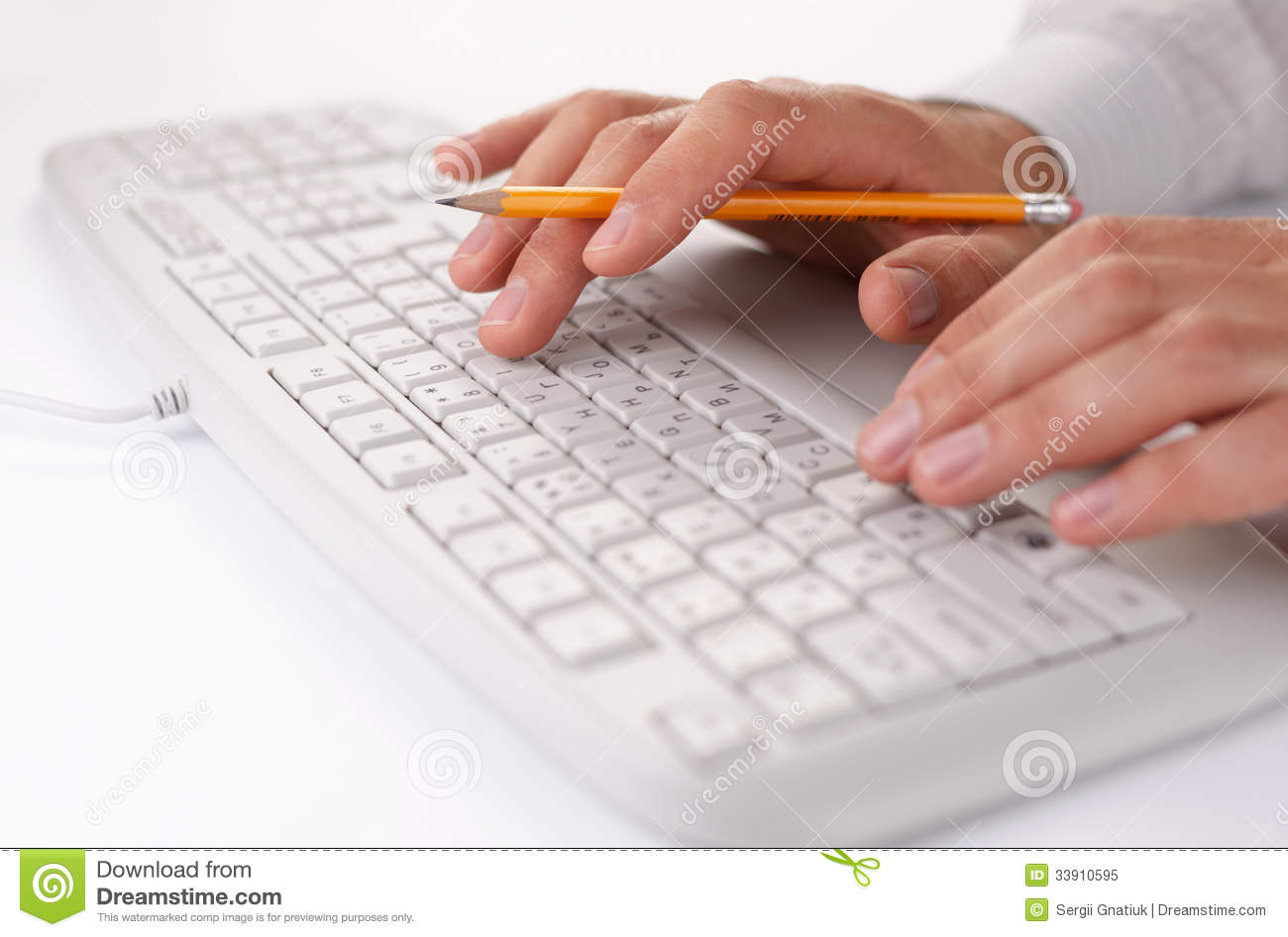 Man typing on a computer keyboard at work royalty free stock photo