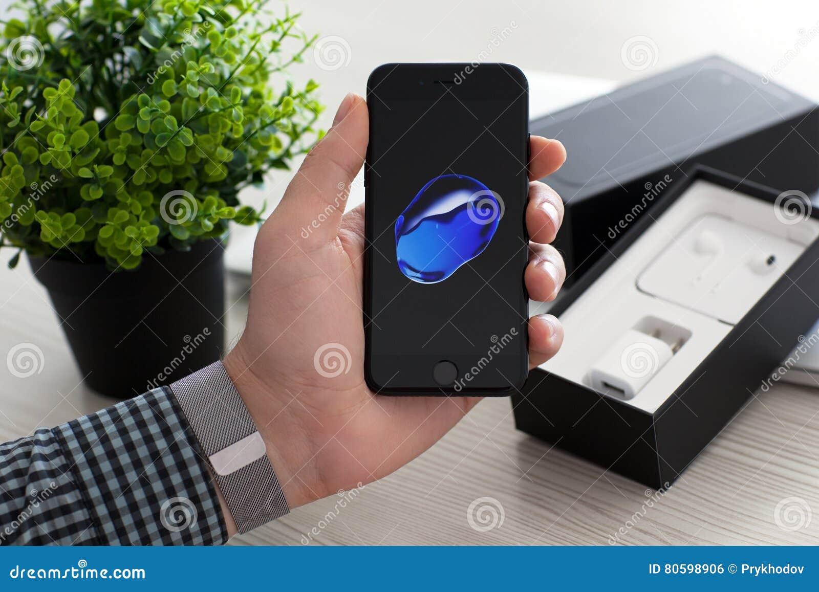 Man Unboxing Iphone 7 Jet Black Onyx Over Macbook Pro Editorial