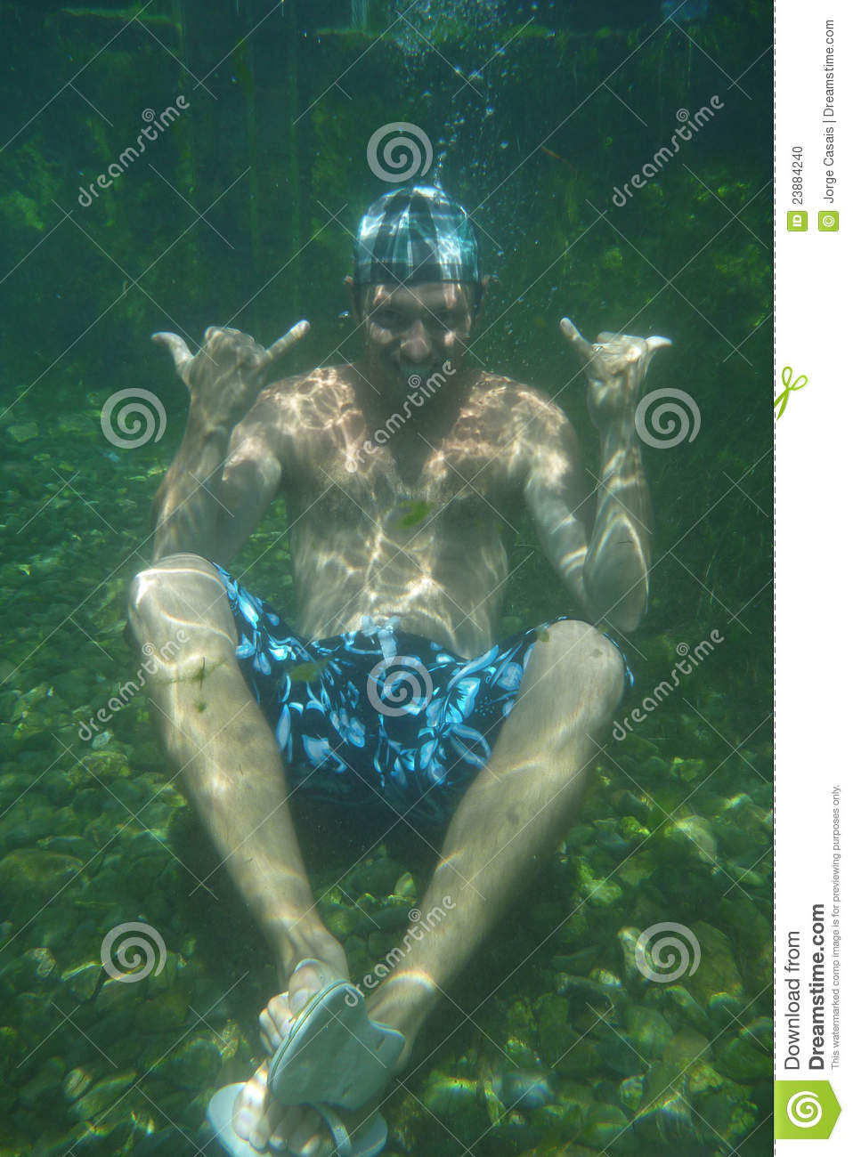 Man underwater in the pool underwater photo