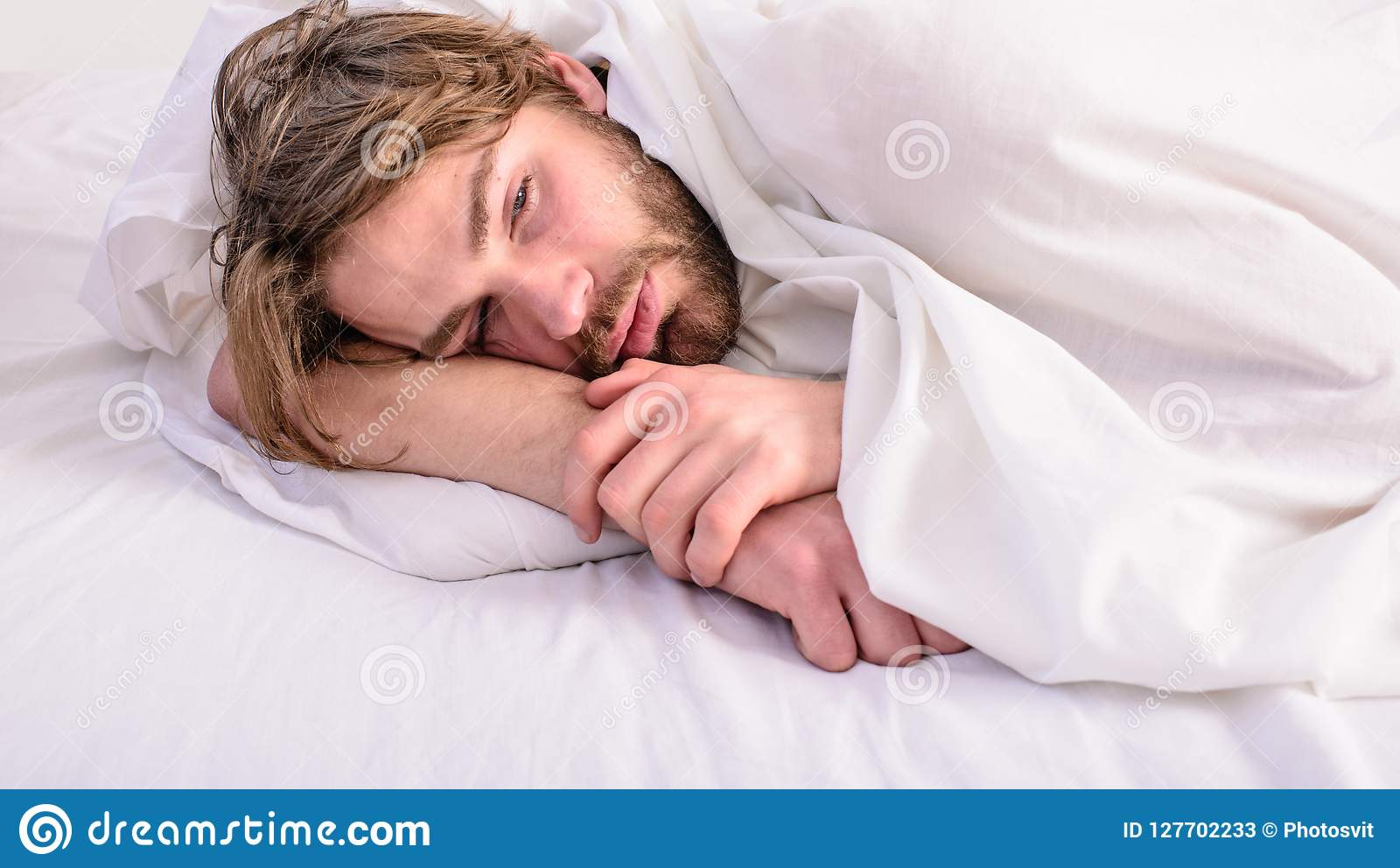 Man unshaven handsome relaxing bed. Man sleepy drowsy unshaven bearded face covered with blanket having rest. Guy lay