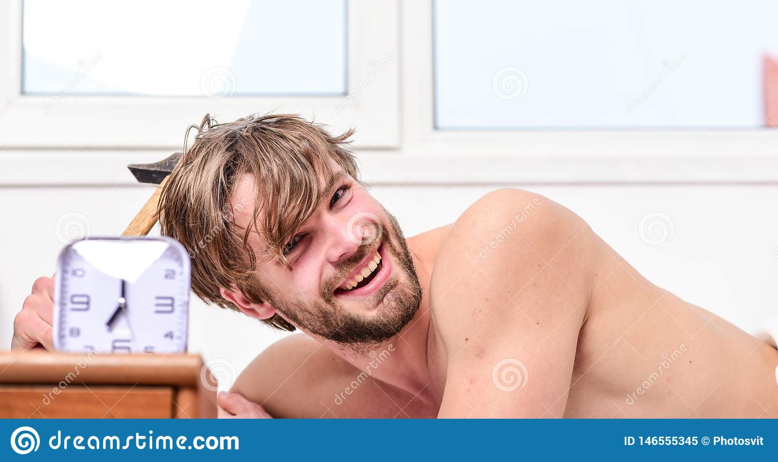 Man unshaven lay bed near alarm clock. Stick schedule. Enough sleep for him. Morning alarm. Wake up early in morning