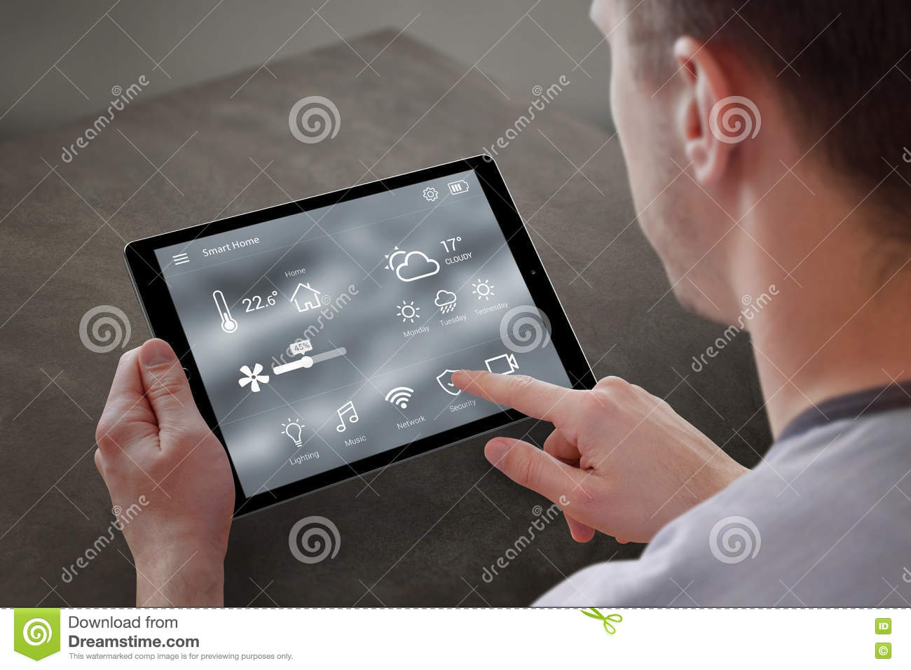 Man use application for smart home control on tablet