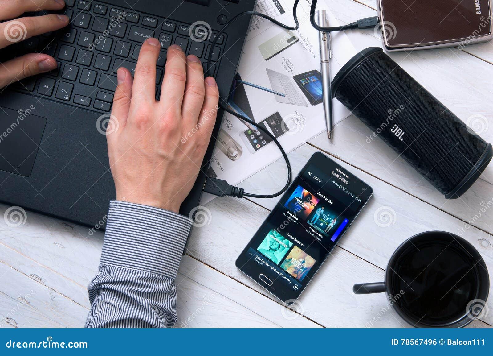 Man uses Spotify application