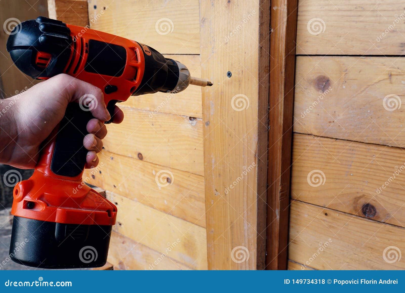 A man using a electric screwdriver
