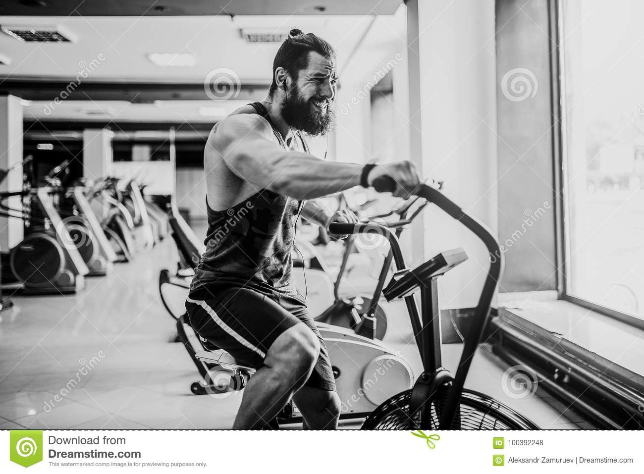 Download Young Man Using Exercise Bike At The Gym Fitness Male Air For