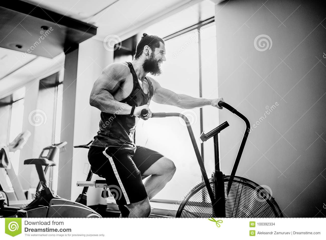 Man Using Exercise Bike At The Gym Fitness Male Air For Cardio Workout Functional Training
