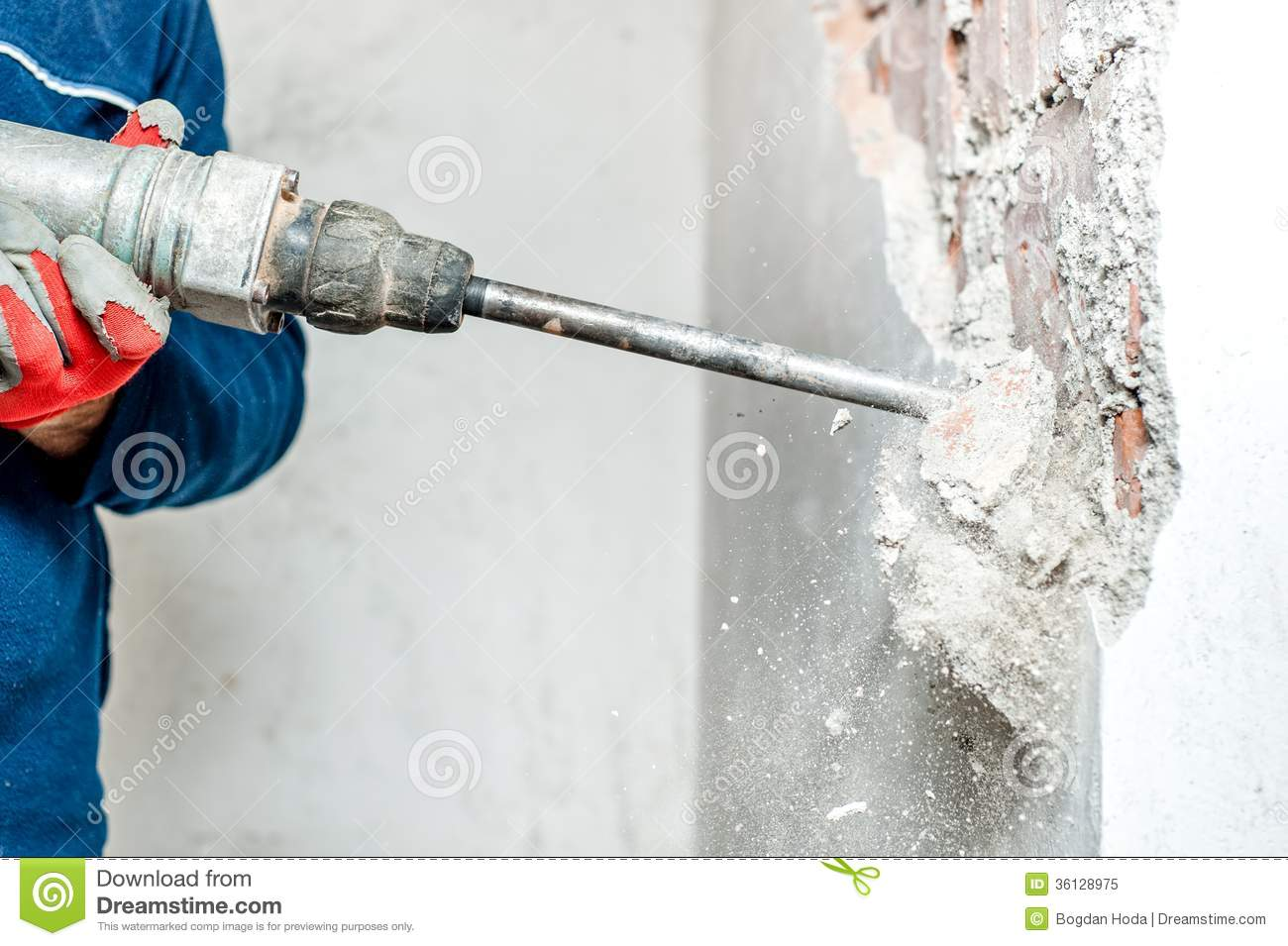 Man Using A Jackhammer To Drill Into Wall Royalty Free