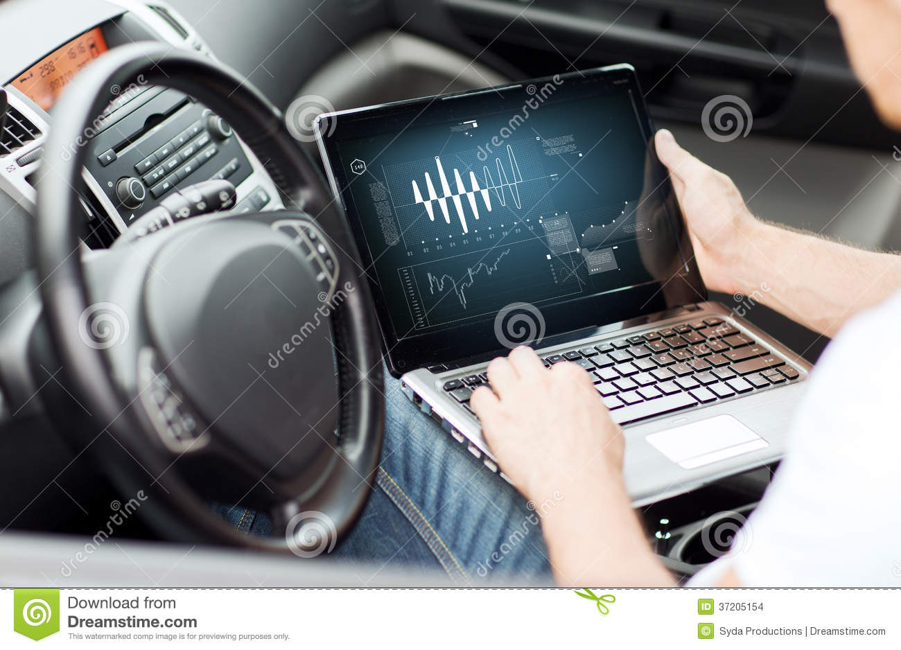 man using laptop computer in car stock images image. Black Bedroom Furniture Sets. Home Design Ideas