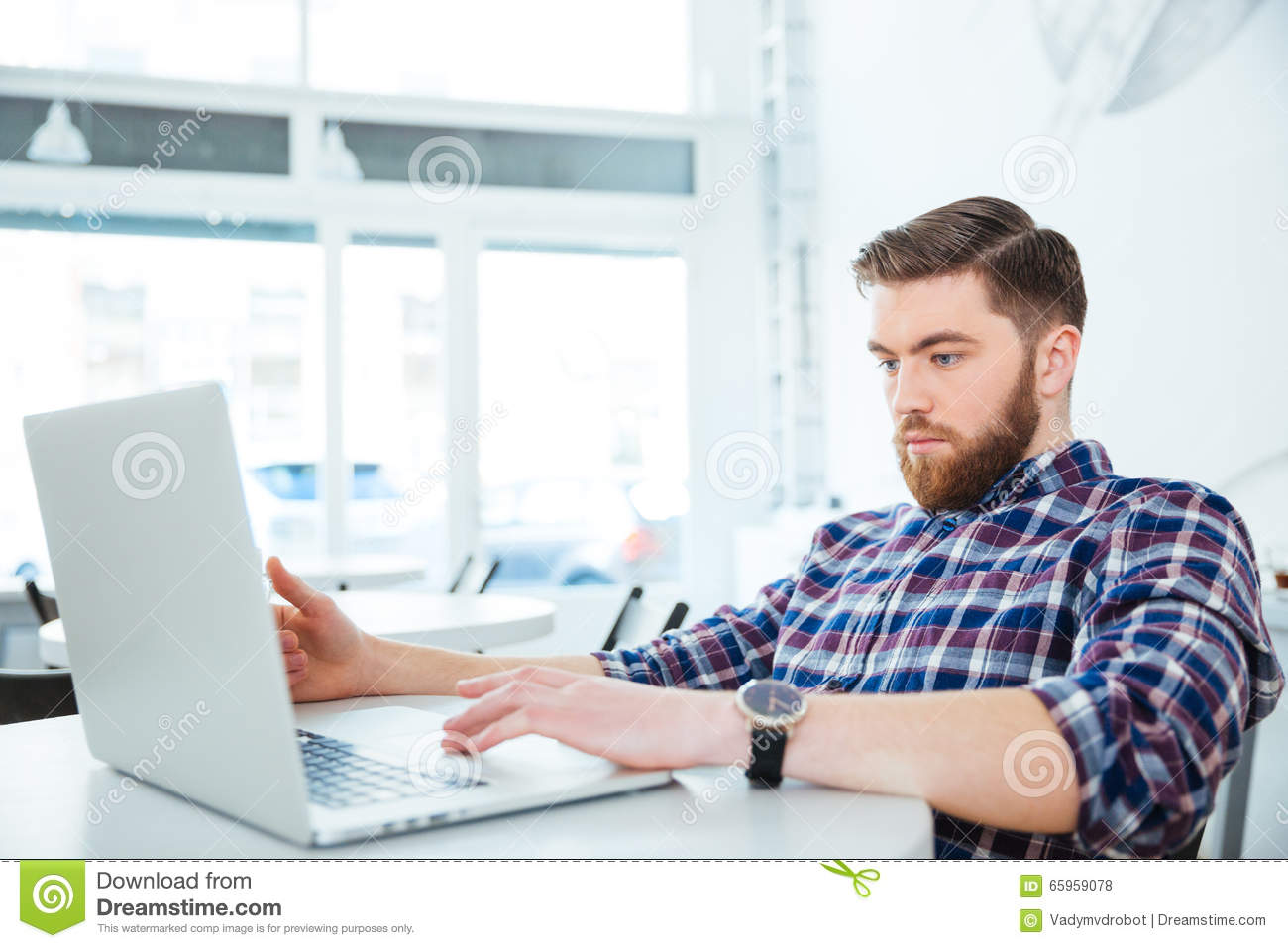 Man using laptop computer in coffee shop stock photo image 65959078 coffee computer laptop man shop sitting table geotapseo Gallery