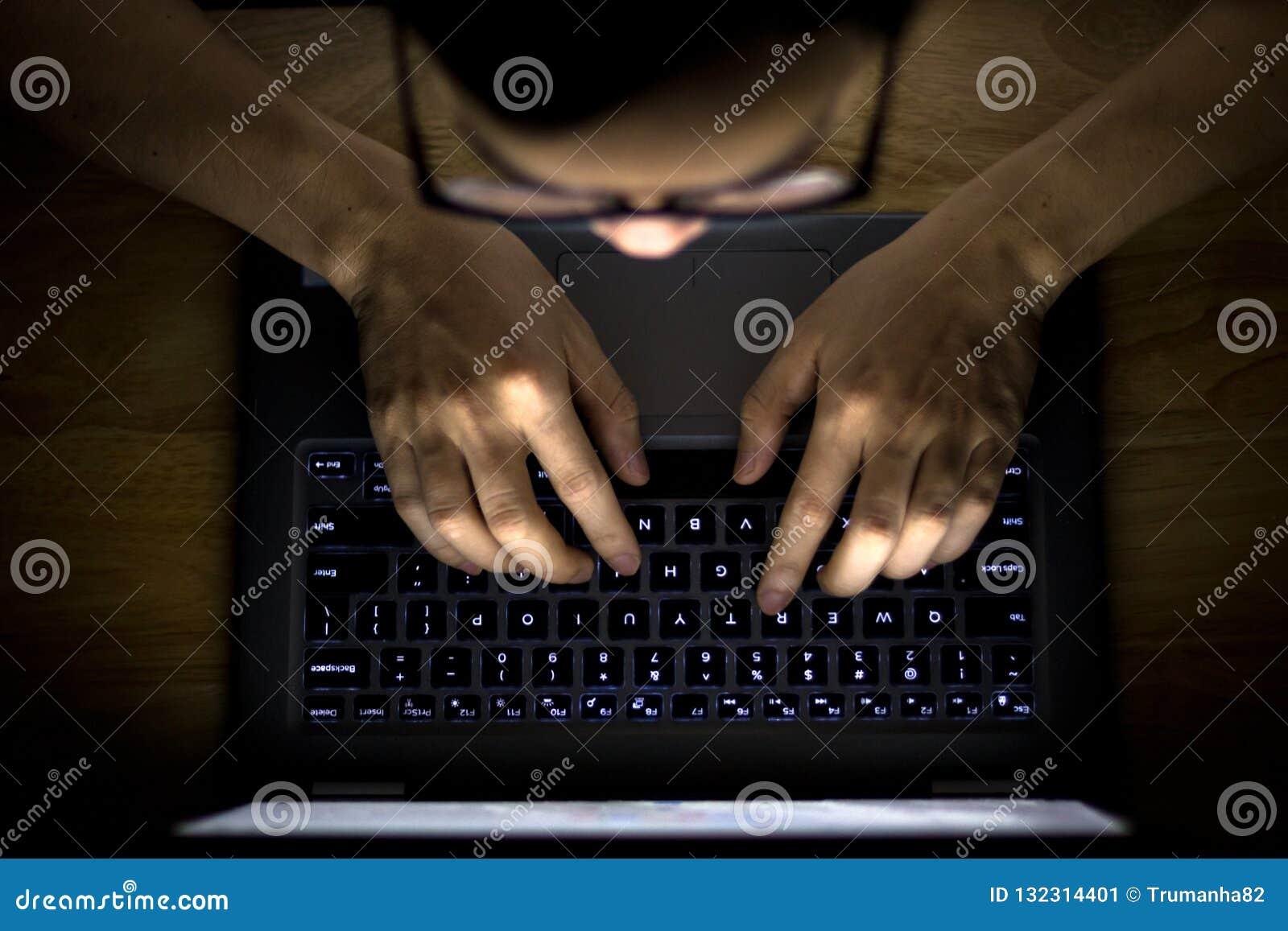 Man Using Laptop in The Dark