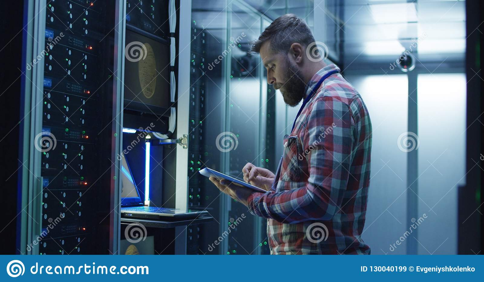 Man using laptop on mining farm in data center