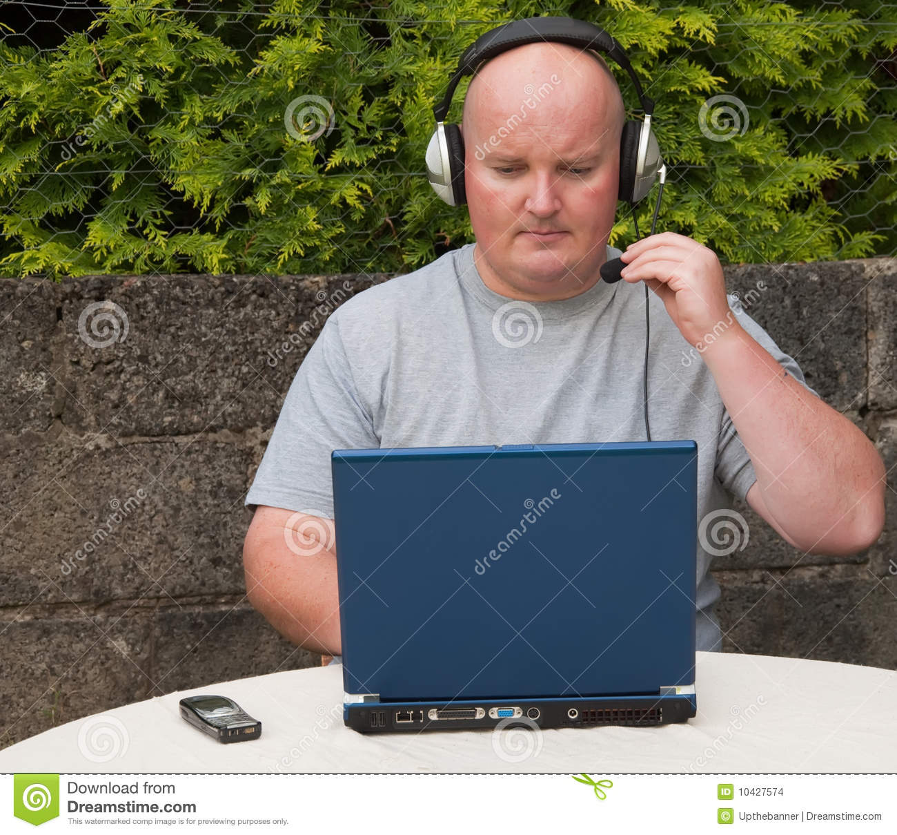 Man using laptop and voip
