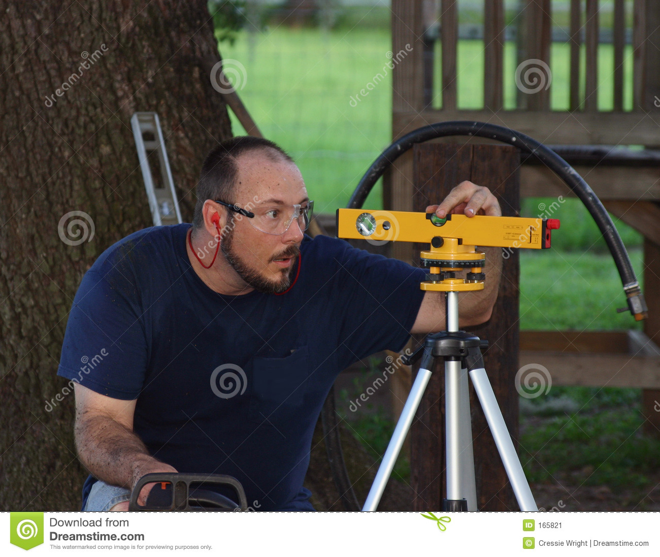 Man Using Laser Level