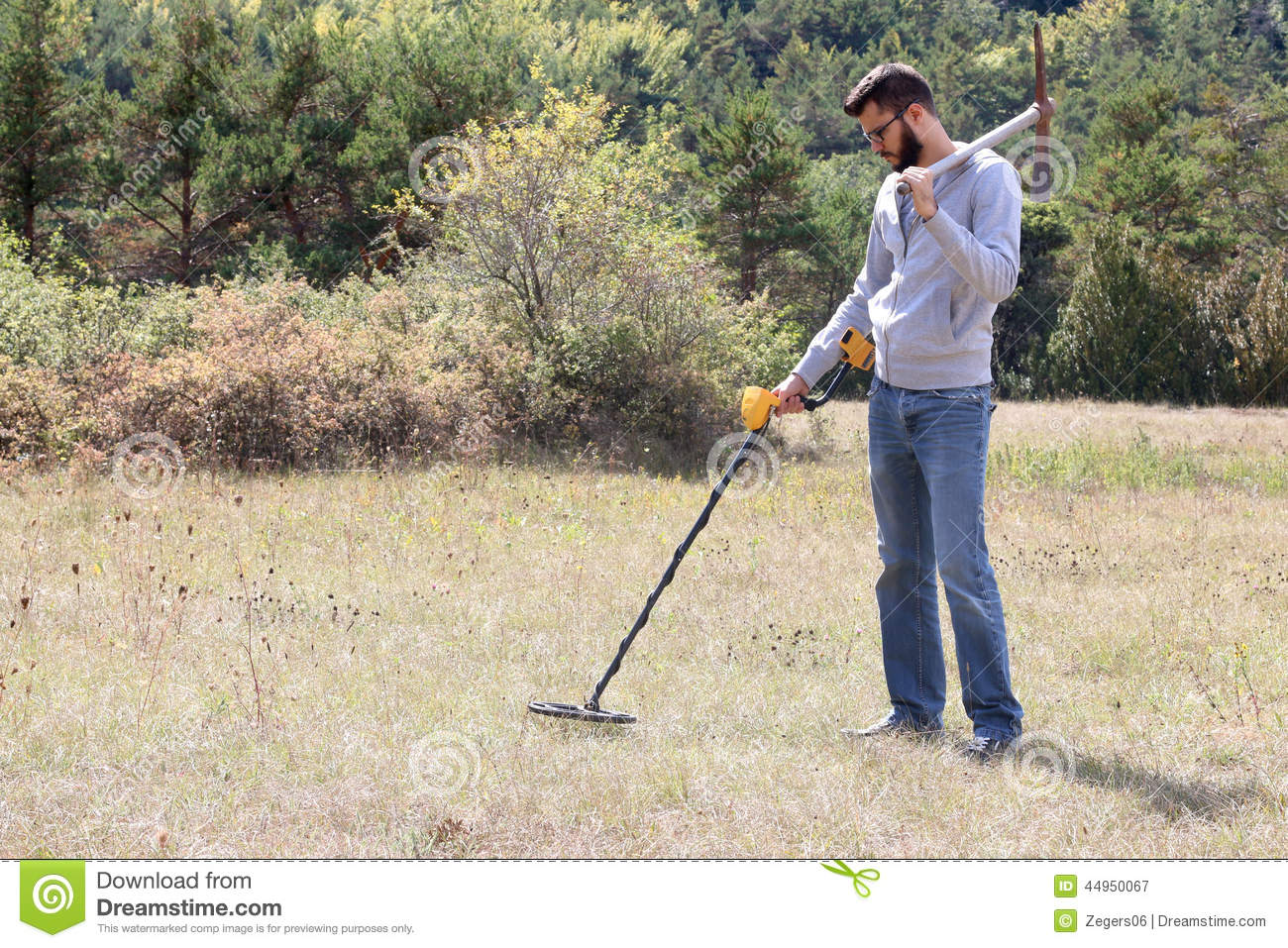 Jew Detector: Man Using A Metal Detector Stock Image. Image Of