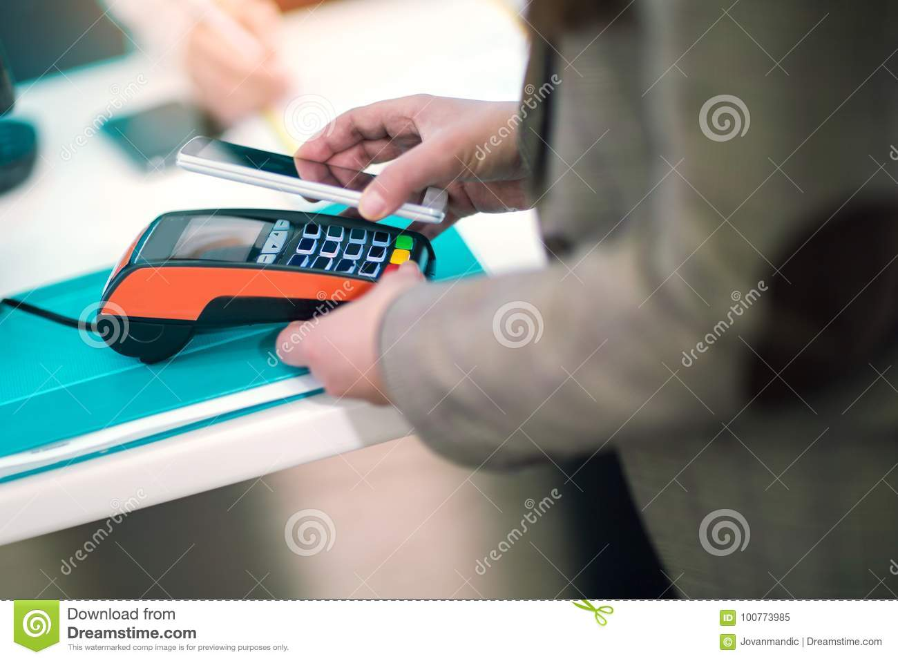Man using mobile phone to pay