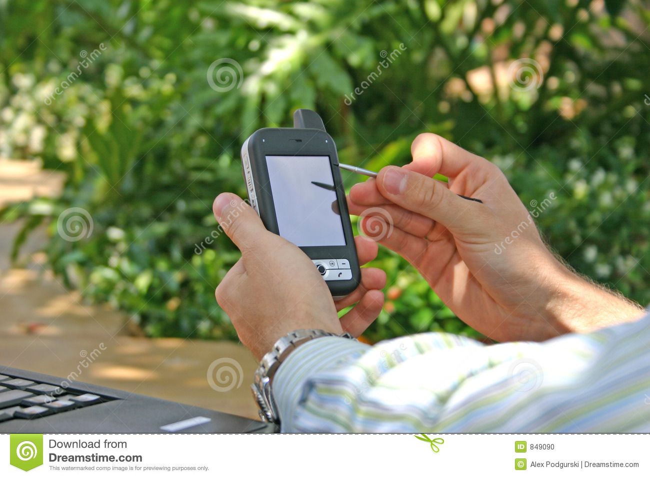 Man Using PDA / Smartphone Outside