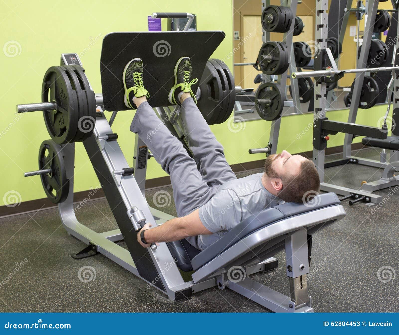 Man Using Plate Loaded Leg Press Stock Image Image Of