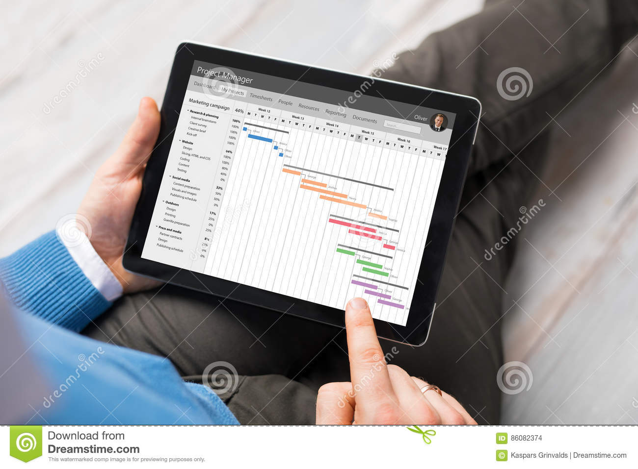 man using project management app on tablet stock photo image of