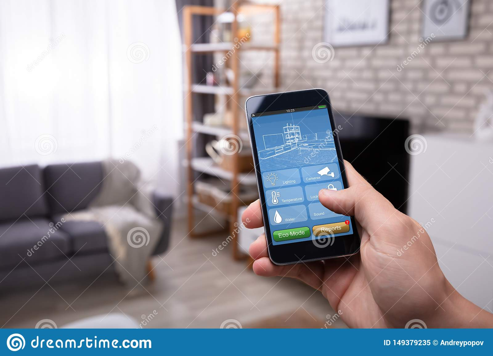 Man Using Smart Home Application On Mobile Phone