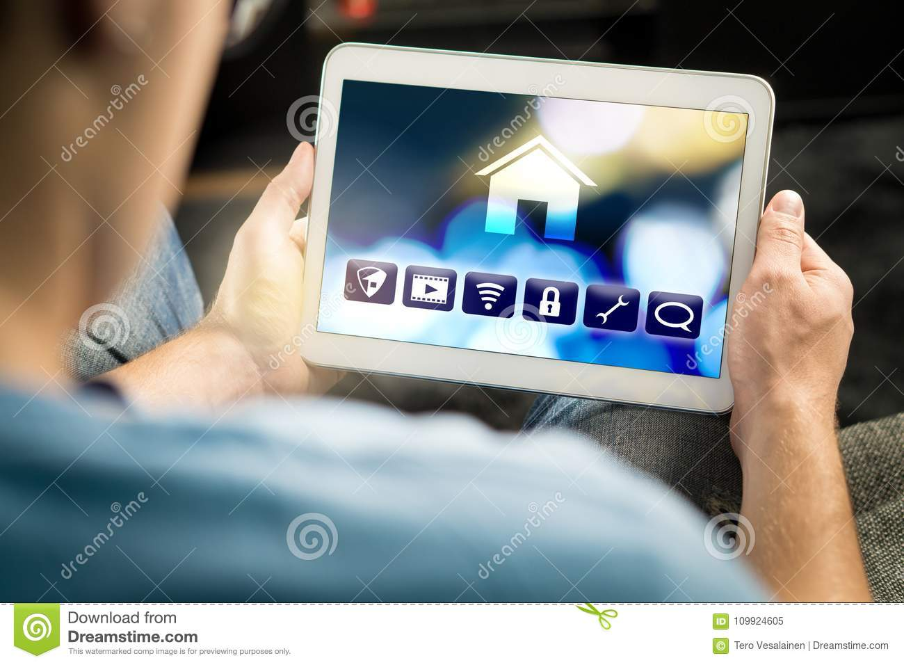Man using smart home application in tablet to control house
