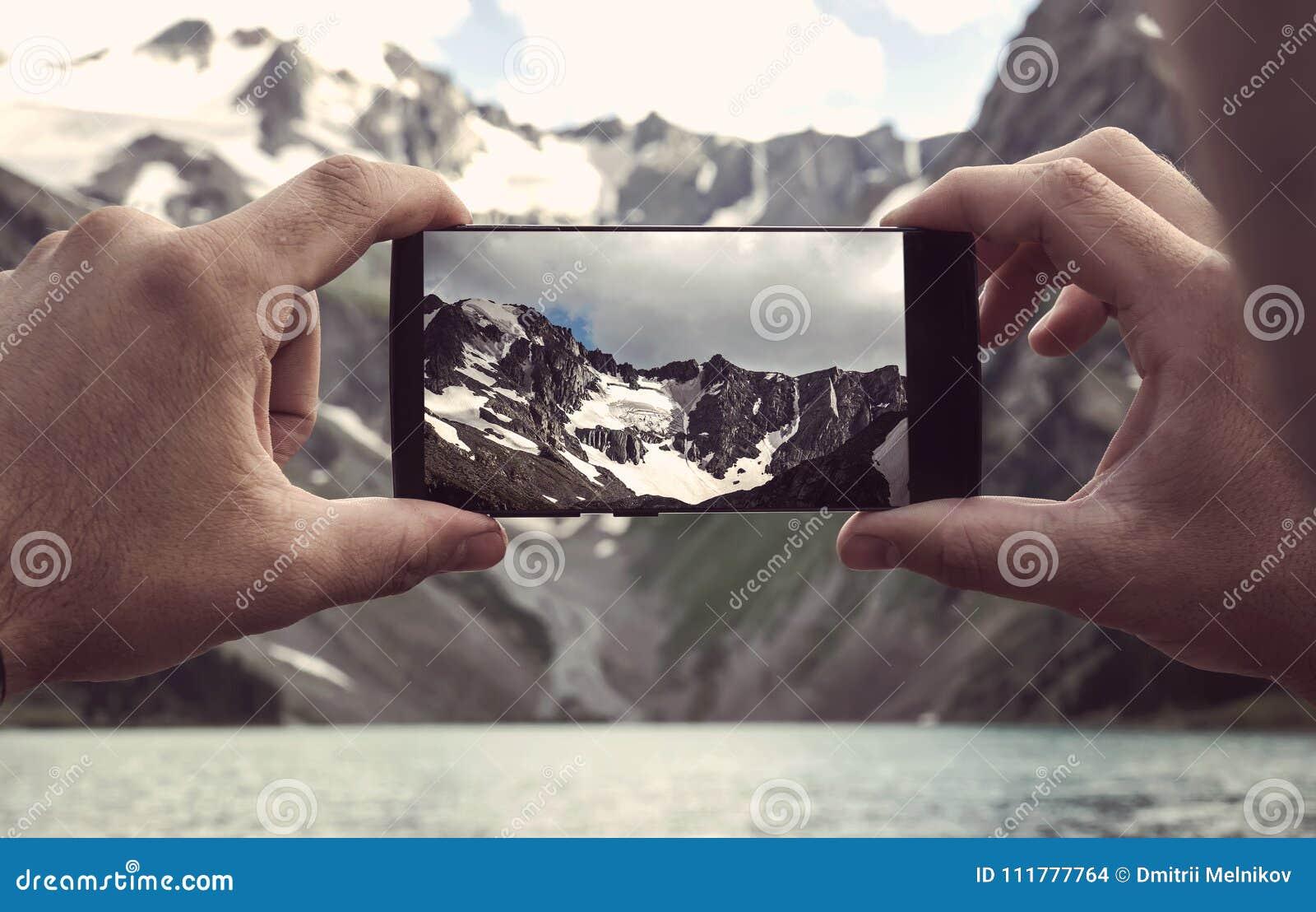 Man using smart phone take a photo