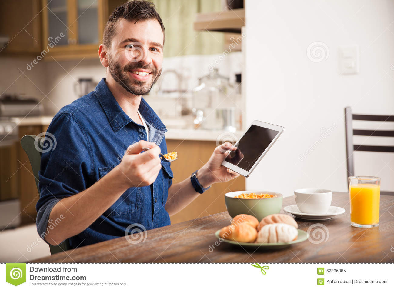Man Using A Tablet Over Breakfast Stock Photo - Image ...