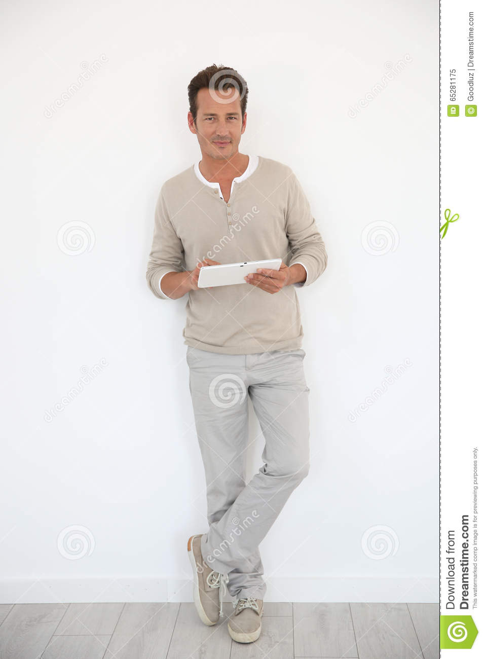 Man using tablet standing isolated