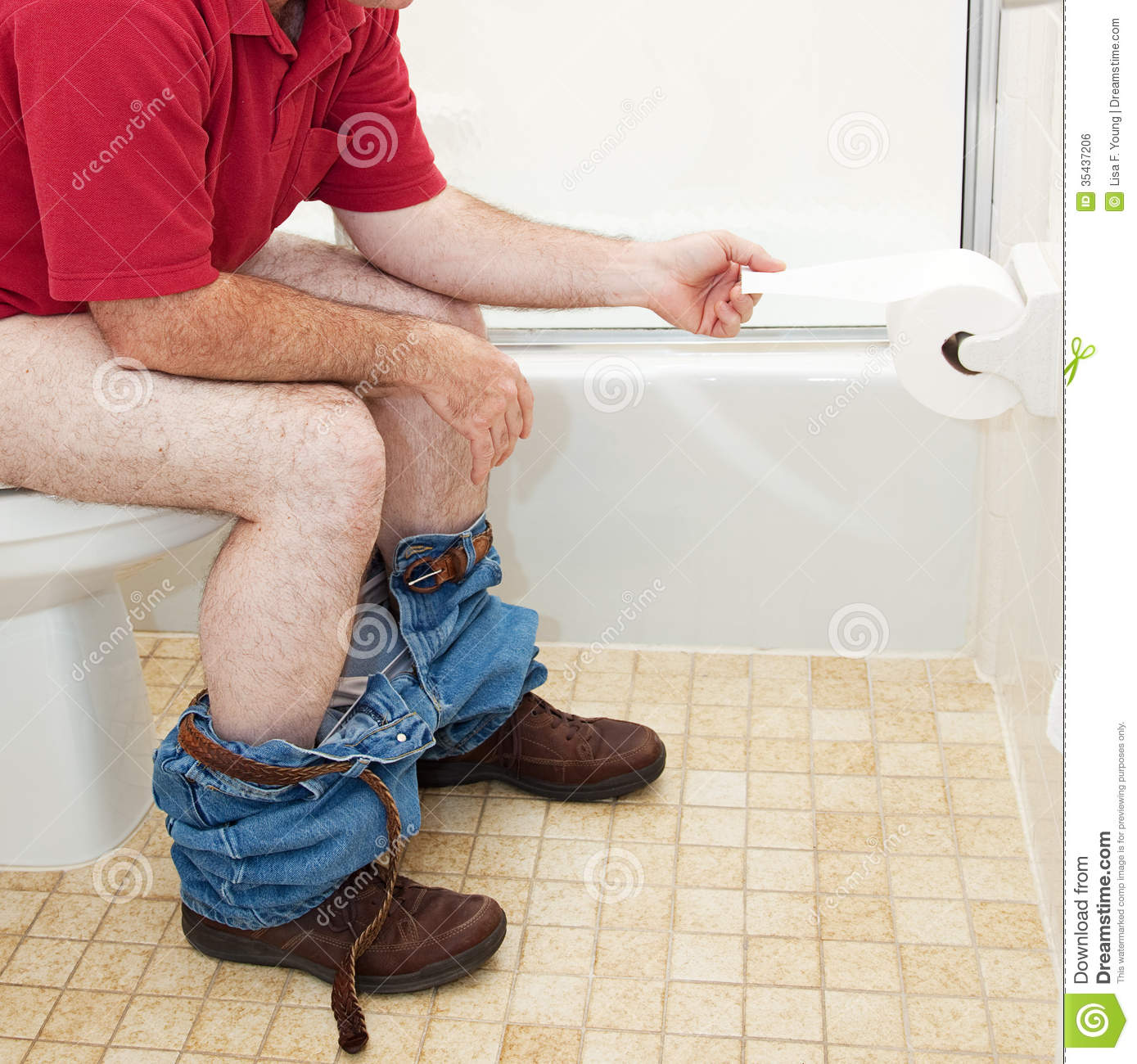 using the bathroom. Man Using Toilet Paper in Bathroom In Stock Photo  Image 35437206