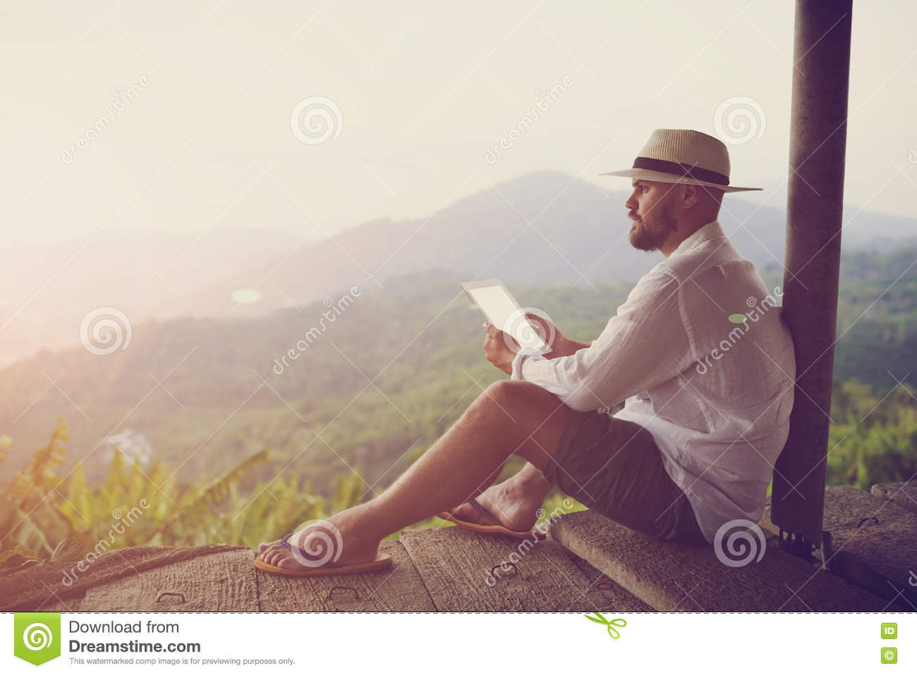 Man using touch pad during summer trip in Latin America