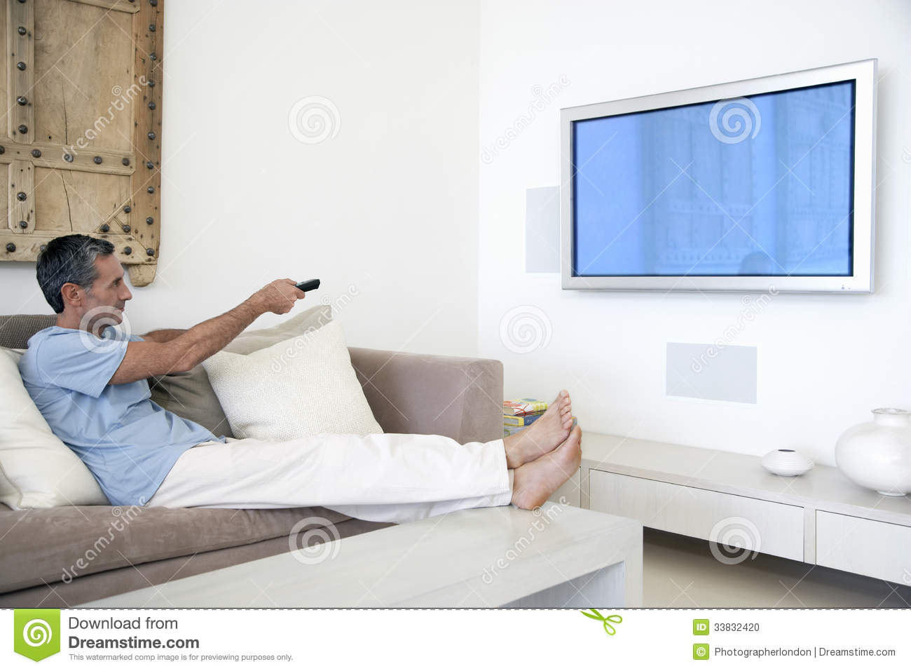 Man Living Room Man Using Tv Remote In Living Room Stock Photo Image 33832420