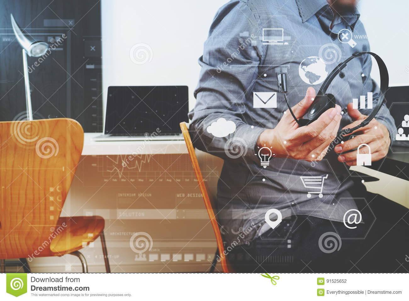 man using voip headset with digital tablet and laptop computer a